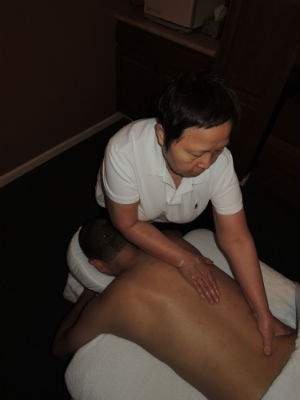Man Getting Lower Back Massaged